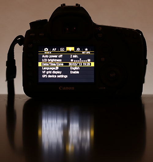 Use the camera LCD menu to change the time or timezone for summer time