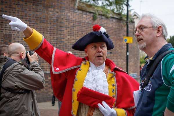 Noel Hannan gets directions from Warwick Town Crier